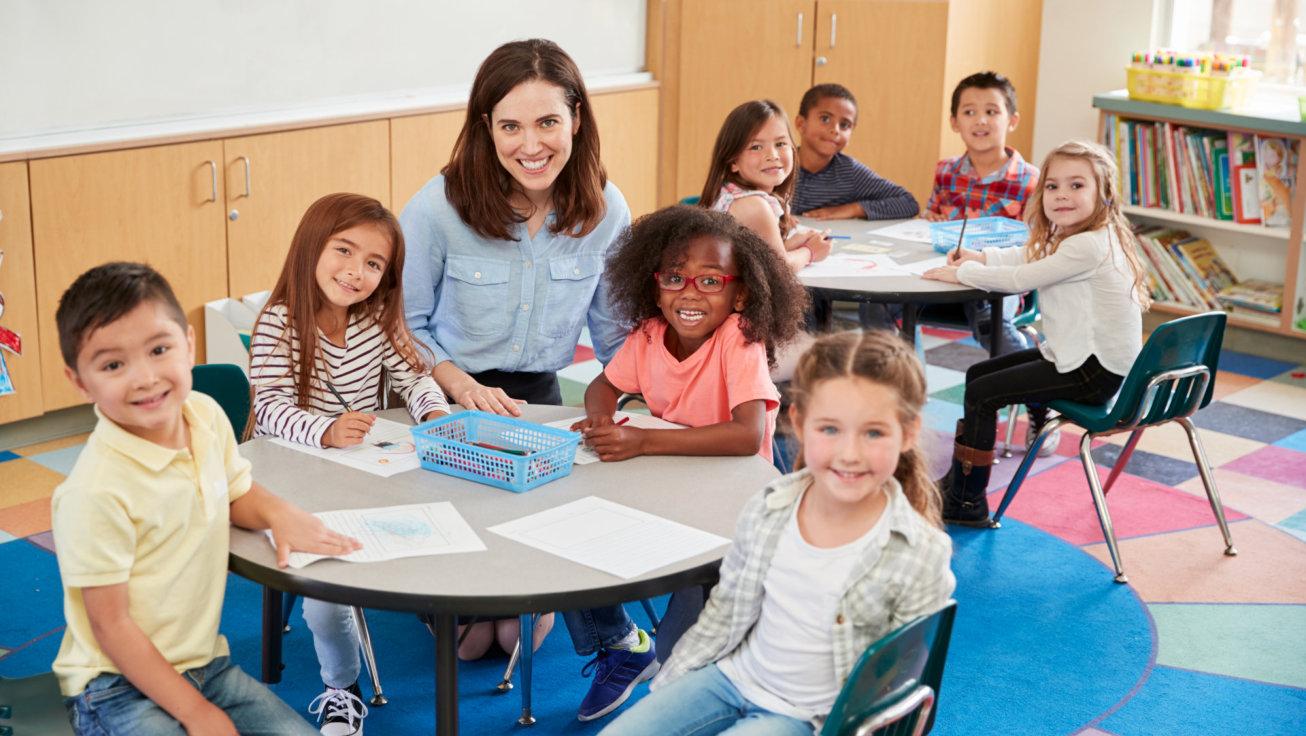 teacher smiling with children