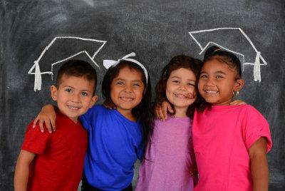 children with graduation cap drawn in their head